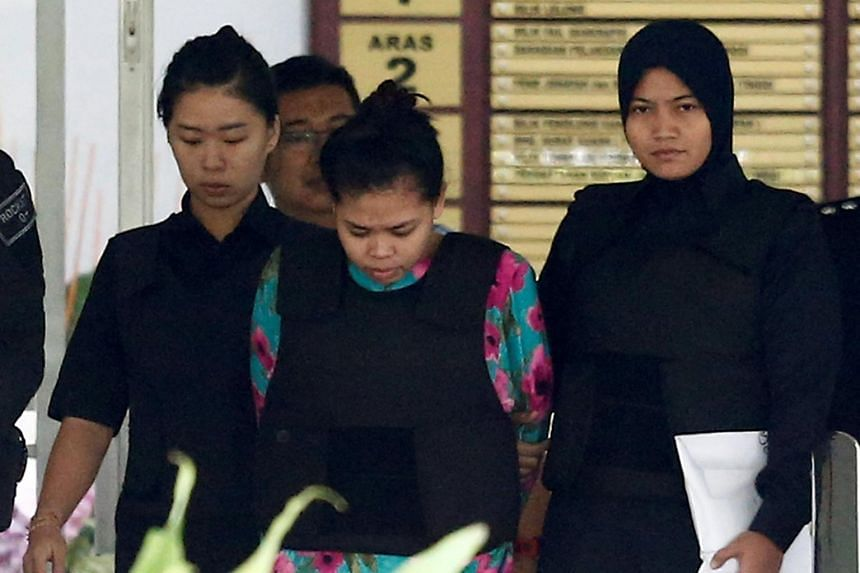 Indonesian Siti Aisyah who is on trial for the killing of Kim Jong Nam, the estranged half-brother of North Korea's leader, is escorted as she leaves the Shah Alam High Court.