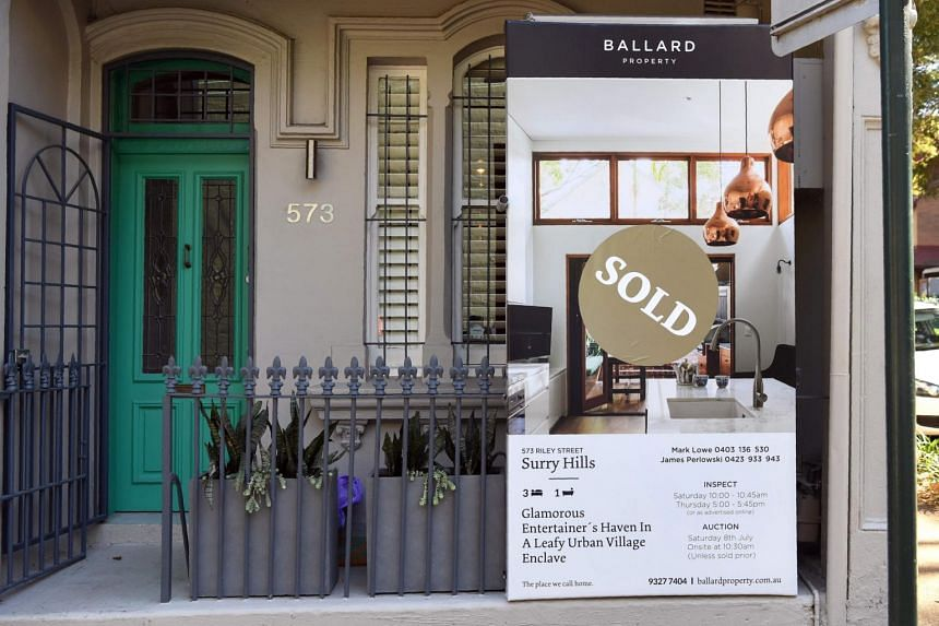 A sold sign on a real estate board advertising residential property is seen in front of a house in Sydney on Aug 1, 2017.