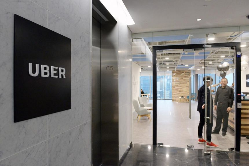 Uber Singapore's new office at 1 Wallich Street, Guoco Tower. Uber will levy a 20-cent-per-minute charge on passengers if their drivers have to wait longer than three minutes at the pick-up location.