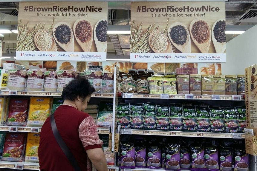 A dedicated brown rice bay with posters and recipe suggestions at NTUC FairPrice in Bedok North on Oct 5, 2017.