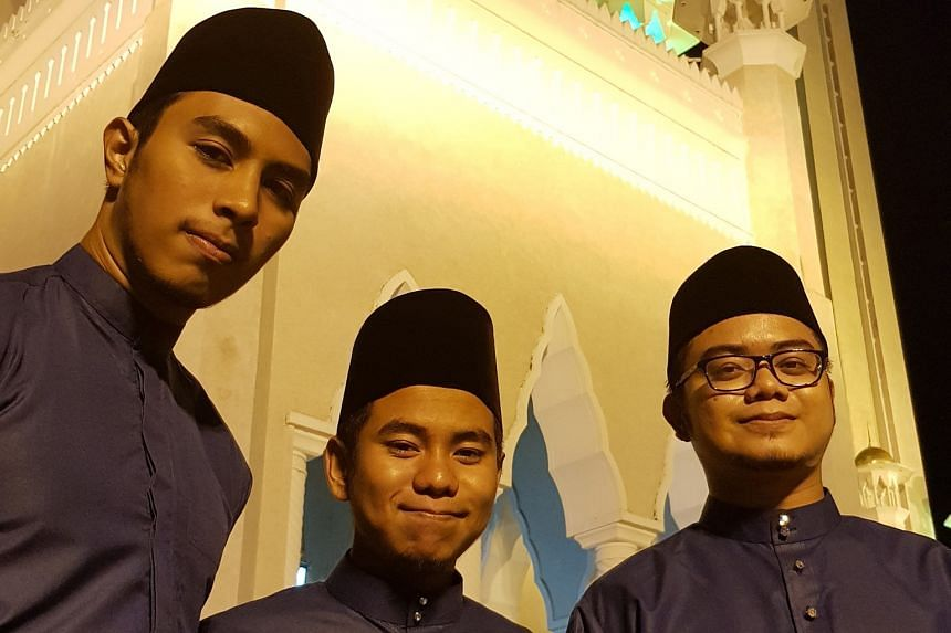 (From left) Muhammad Amruu Hussein Ismail, Muhammad Imran Mohammad Yusoff and Afiq Zikry Zulkiffli will be at the royal procession dressed in their school uniforms of blue Malay traditional costumes with songkok and songket sarong.