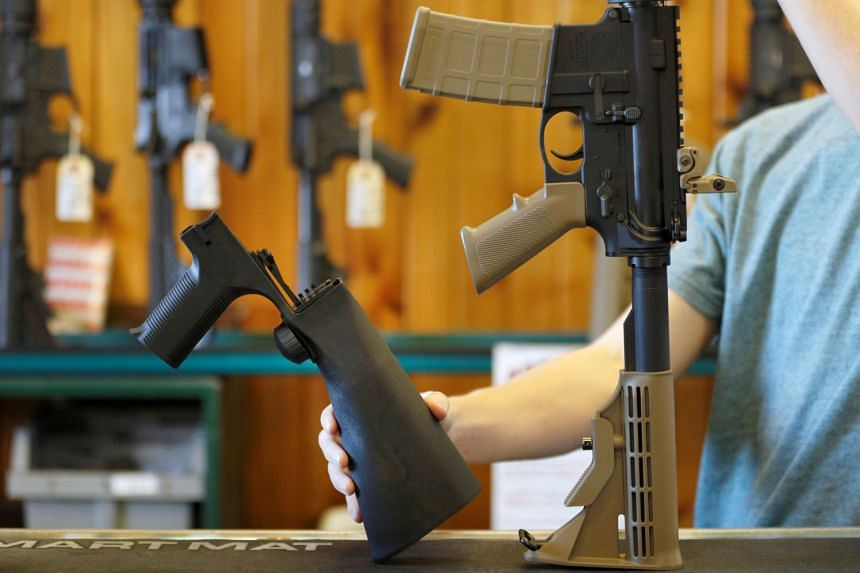 A bump fire stock (left), which attaches to a semi-automatic rifle to increase the firing rate, is seen at a gun shop in Utah.