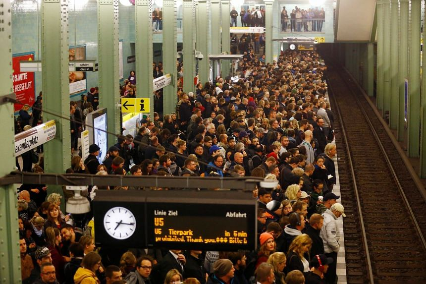 People wait at subway station Alexanderplatz during stormy weather in Berlin, Oct 5, 2017.