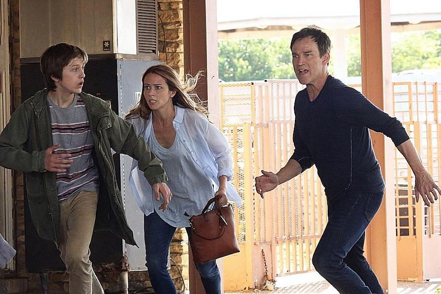 The Strucker family, played by (from left) Percy Hynes White, Amy Acker and Stephen Moyer, are on the run from the government.