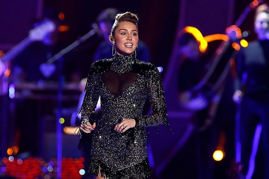 Miley Cyrus performing at the iHeartRadio Music Festival in Las Vegas last month.