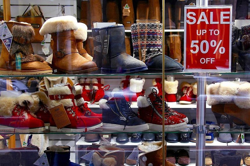 A store selling boots in central Sydney. Australian retailers have suffered their worst decline in sales since early 2013 as debt-laden consumers tighten their purse strings, slashing spending on food, furniture and clothing - an outcome that bodes p