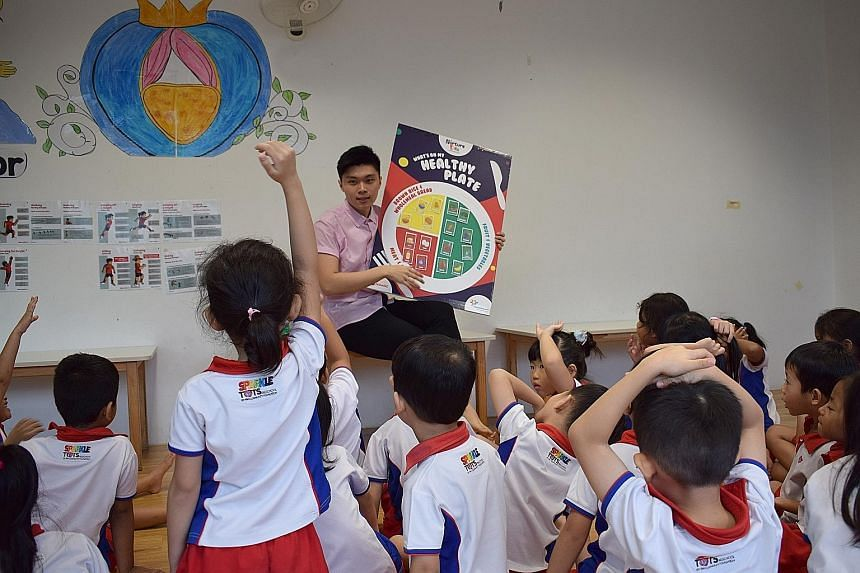 Nurture Kids sessions are conducted on each pre-school's premises. Led by expert instructors, children learn fundamental movement skills like dodging and leaping over obstacles and throwing and catching balls (above). Nutrition workshops (below) invo