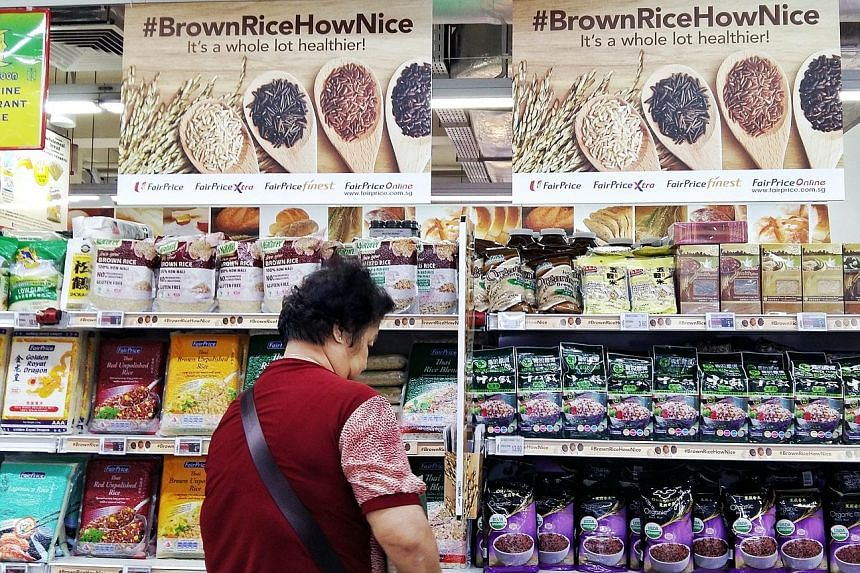 The brown rice bay at FairPrice in Bedok North. The supermarket chain is selling white and brown rice under its housebrands at the same price till Oct 18 in a move to support the national drive to fight diabetes. Other chains, such as Cold Storage an