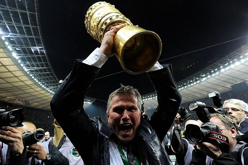 Jupp Heynckes lifting the German Cup in 2013, the year Bayern Munich won the treble. Now 72, the German is tipped for a fourth spell at the club.