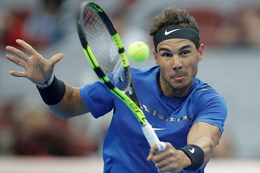 Spaniard Rafael Nadal in action against Karen Khachanov of Russia in the fourth round of the China Open yesterday. The world No. 1 faces a stiff quarter-final test against American John Isner, whose game revolves around a huge serve.