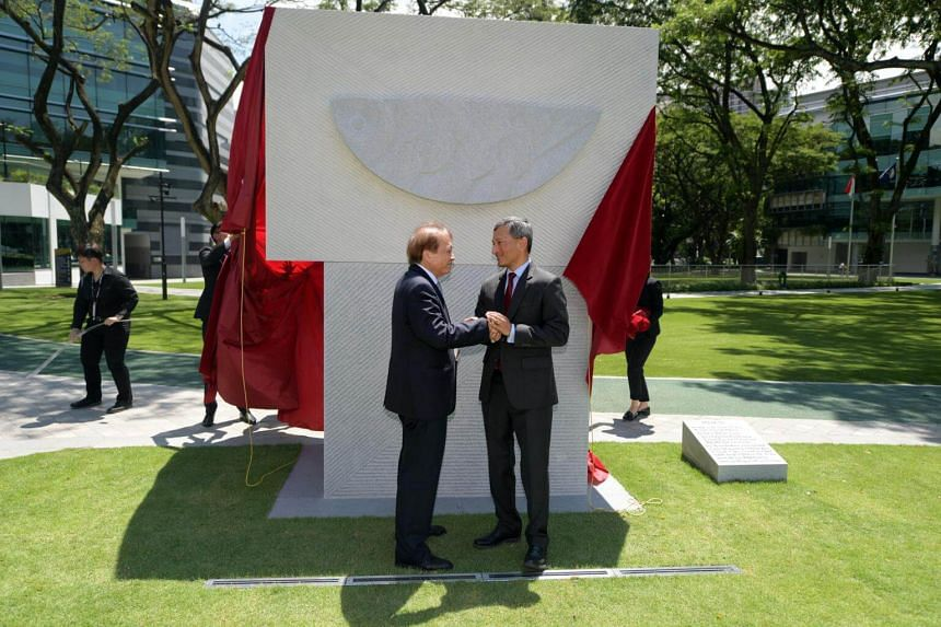 Dr Vivian Balakrishnan (right), Minister for Foreign Affairs, and artist Tan Swie Hian unveil a granite sculpture titled Asean50, to mark the golden jubilee of Asean, on Oct 6, 2017