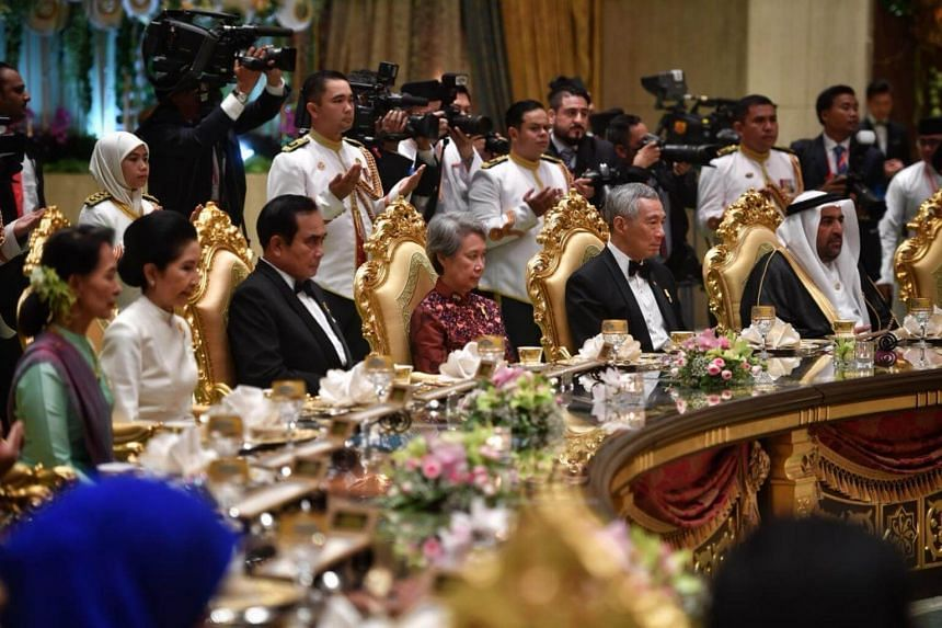 Prime Minister Lee Hsien Loong and Mrs Lee were flanked by Thai Prime Minister Prayut Chan-o-cha and United Arab Emirates Minister of State Rashid Ahmed bin Fahad.