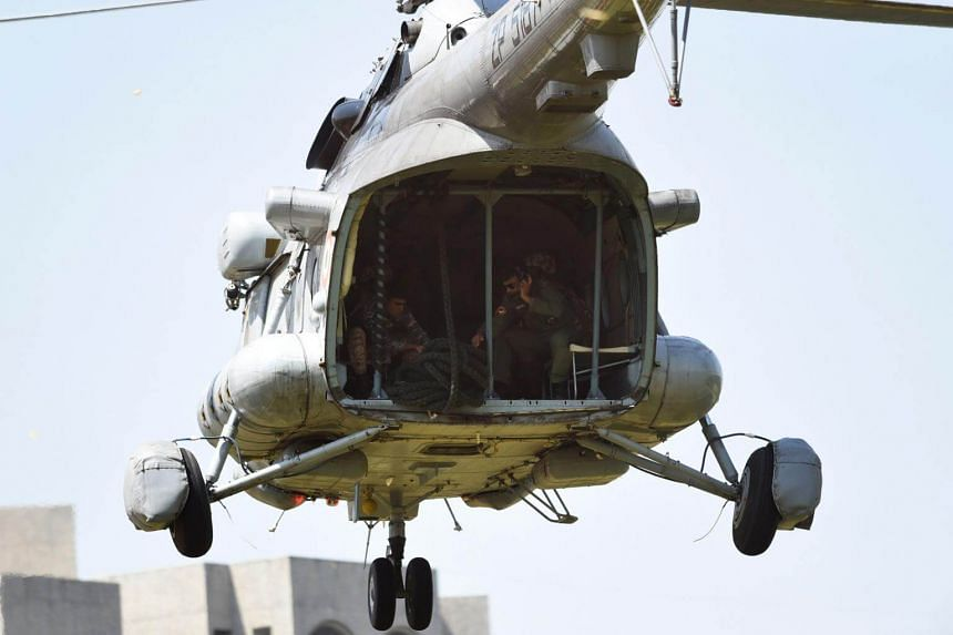 Indian Air Force crew members prepare to lower a rope from an IAF MI-17 V-5 helicopter on Oct 5, 2017.  The Indian Air Force has a high rate of crashes owing to its ageing fleet.