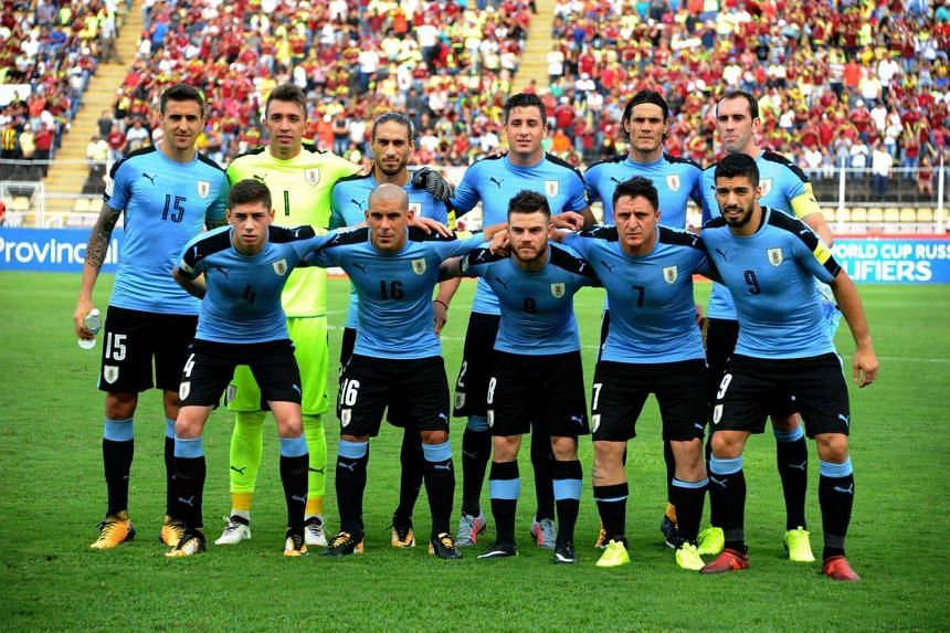 Uruguay players pose for pictures before the start of their 2018 World Cup qualifier football match against Venezuela in San Cristobal, Venezuela, on Oct 5, 2017.