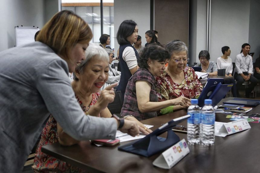 Participants practise posting items up for sale on Carousell via the iPad during a SkillsFuture for Digital Workplace course at the Lifelong Learning Institute on Oct 5, 2017.