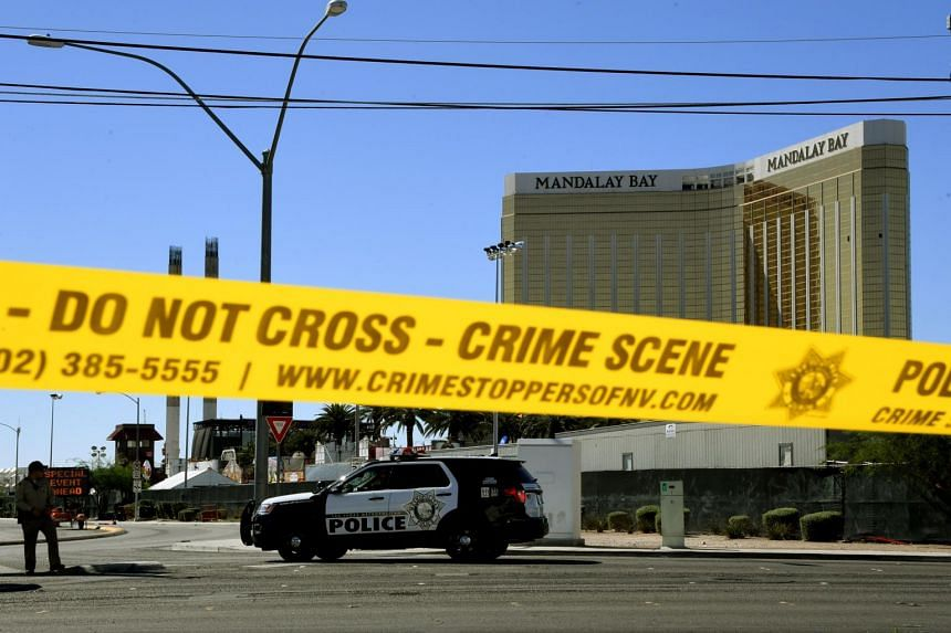 Crime scene tape surrounds the Mandalay Hotel after a gunman killed at least 58 people and wounded more than 500 others when he opened fire on a country music concert in Las Vegas, Nevada on Oct 2, 2017.
