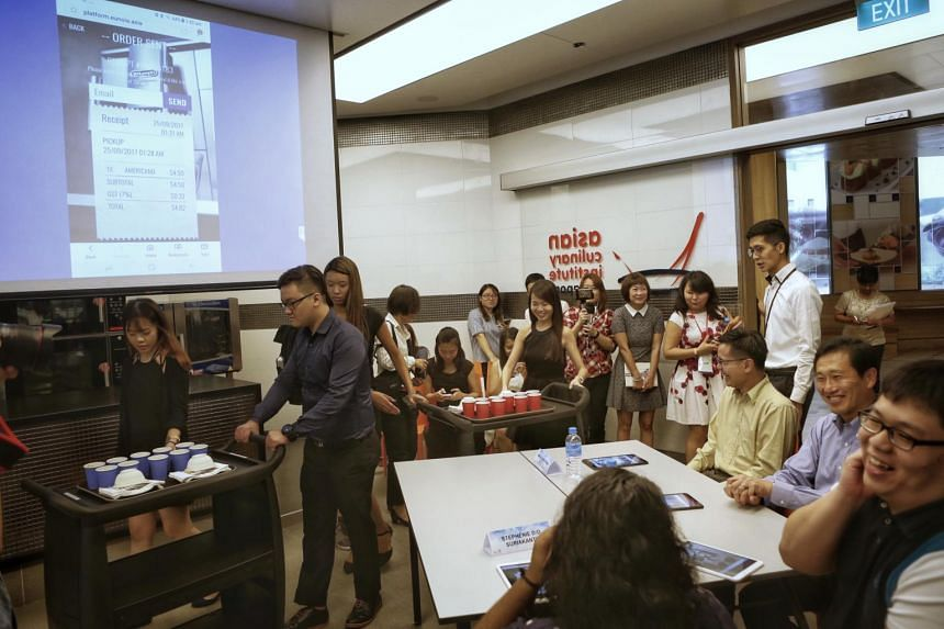 Coffee purchased through a cashless transaction being served to Education Minister (Higher Education and Skills) Ong Ye Kung and participants in a SkillsFuture for Digital Workplace course at the Lifelong Learning Institute on Oct 5, 2017.