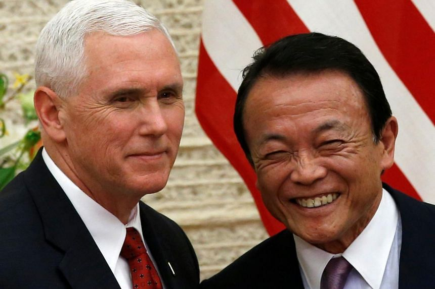 US Vice President Mike Pence (left) and Japan's Deputy Prime Minister Taro Aso attend their joint news conference after their talks at the Prime Minister Shinzo Abe's official residence in Tokyo, Japan on April 18, 2017