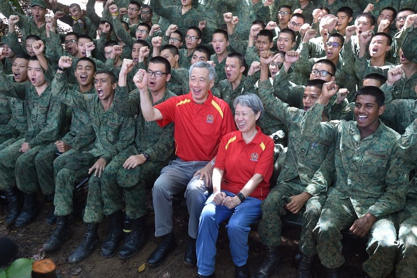 PM Lee cheering with the soldiers from 6th Battalion, Singapore Infantry Regiment, at the end of their training on Friday (Oct 6).