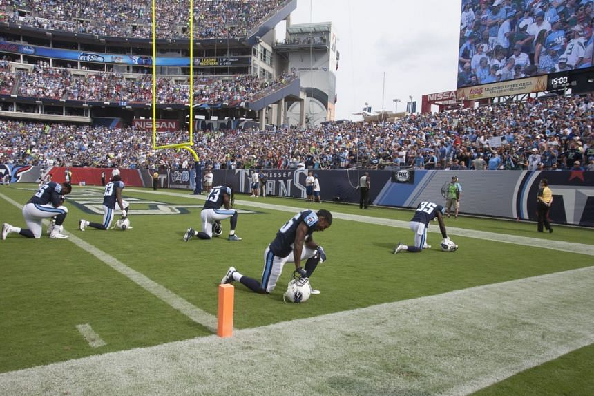 The Tennessee Titans kneeling in protest before their Sept 24 game in Nashville against comments by US President Donald J. Trump calling for the firing of NFL players who don't stand for the national anthem.
