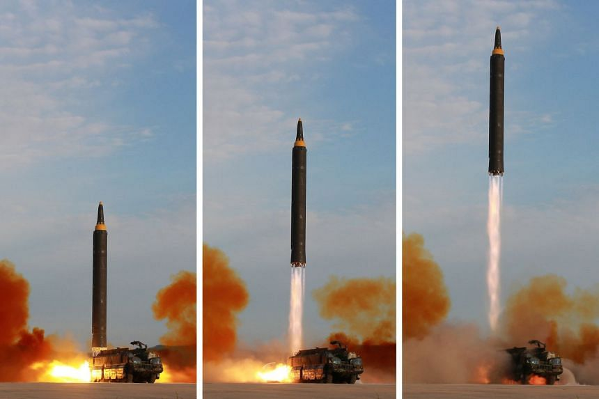 North Korean leader Kim Jong Un (not pictured) guides the launch of a Hwasong-12 missile.