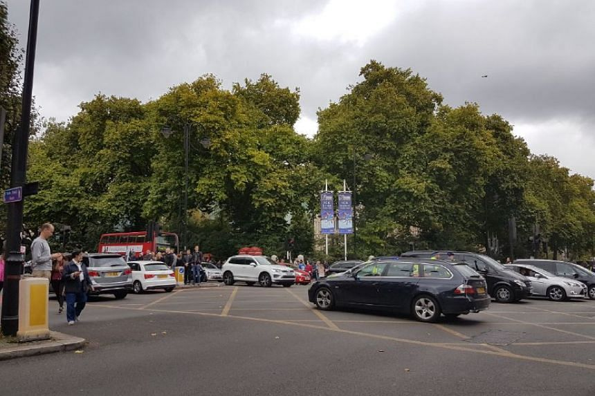 A man has been detained at the scene where a car crashed into a pavement near the Natural History Museum in London.