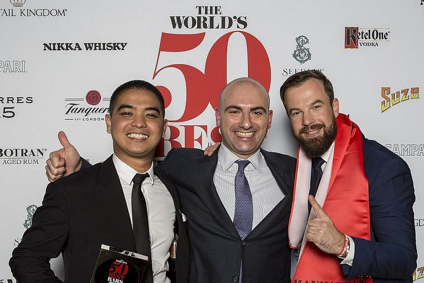(From left) Cedric Mendoza, head bartender at Manhattan cocktail bar in Singapore, which was named the Best Bar in Asia; Mr Matthew Magliocco, global sales director at Michter's Distillery, which sponsored that title; and Manhattan's bar manager Phil