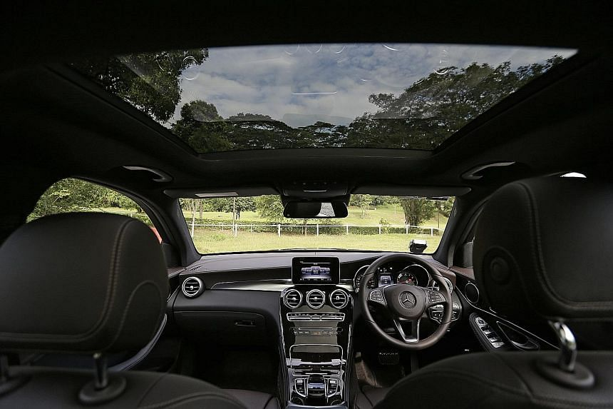The Mercedes-Benz GLC200 (above) is less powerful than the GLC250, but it has an equally roomy cabin with modern-day features.