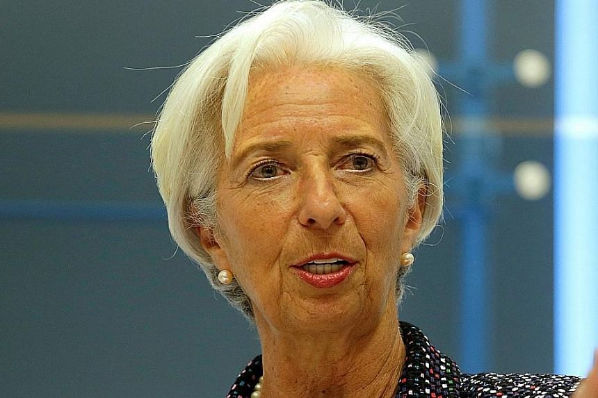 Countries should try to boost productivity to lift wages, says IMF chief Christine Lagarde.