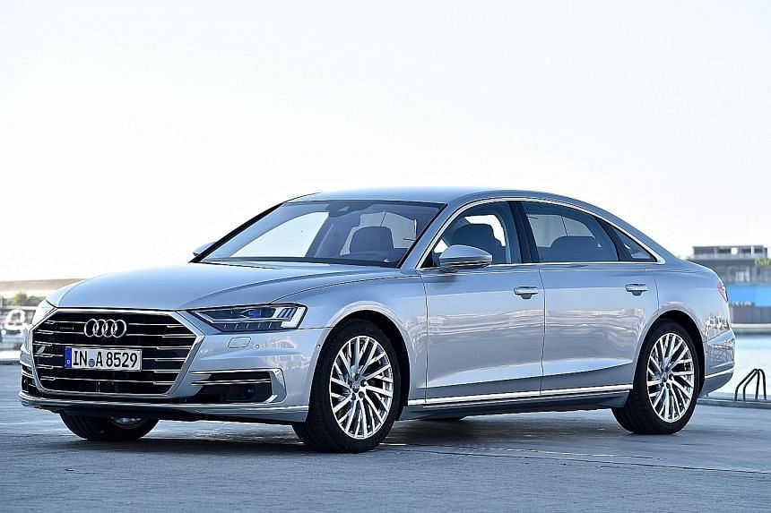 Audi's latest flagship A8 is bigger and smoother, gliding like a yacht over calm waters. Check out its legroom (below).