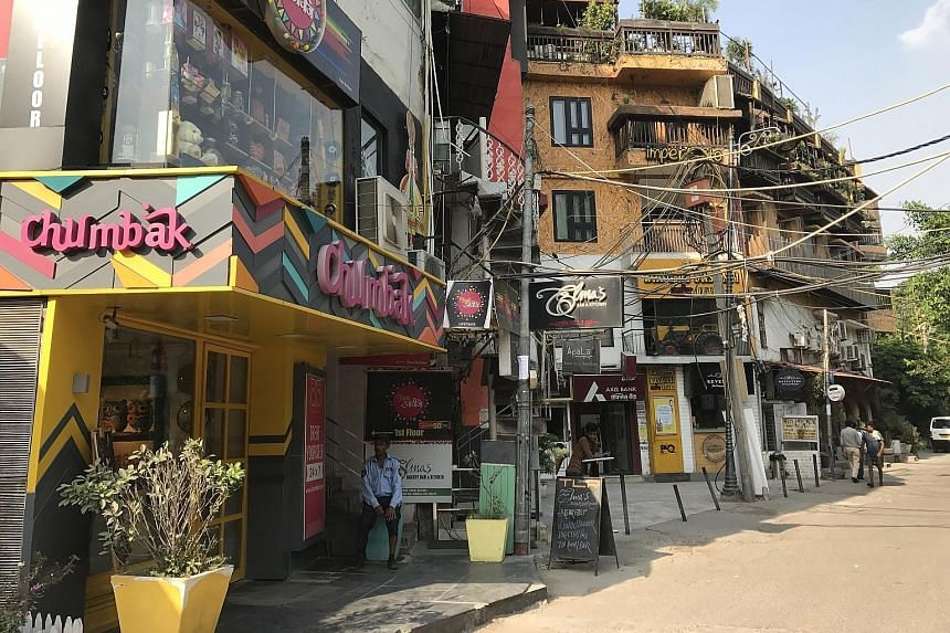 Restaurants line the main lane in Hauz Khas Village, a popular spot for a night out in capital city Delhi. The ruins of a madrasah and tomb complex, which were built around a water tank, in Hauz Khas Village date back to the 14th century.