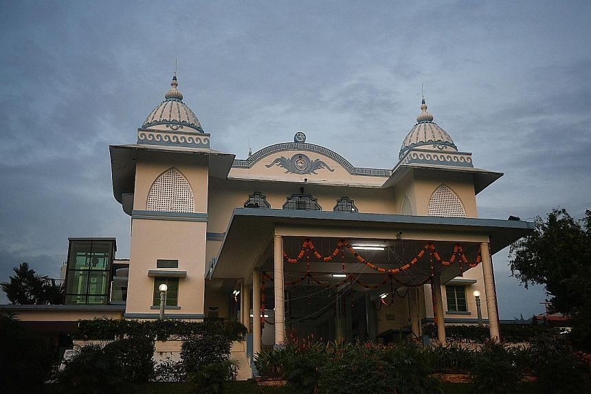 The blue-and-cream Sri Ramakrishna Temple is one of three conserved buildings at the Ramakrishna Mission.