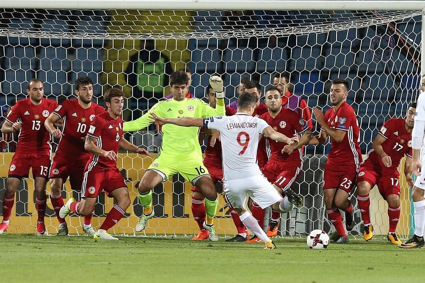 Striker Robert Lewandowski blasting home an indirect free kick in the penalty box in the 25th minute as Poland hammered Armenia 6-1 on Thursday to leave them on the brink of qualification for next year's World Cup Finals in Russia. The Bayern Munich