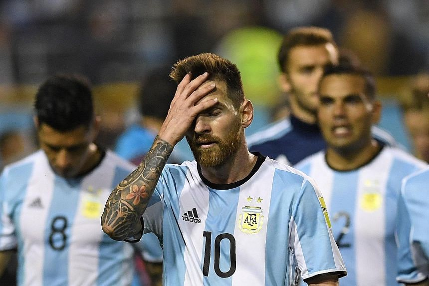 A disappointed Lionel Messi, who hit the post in the second half against Peru, trooping off with his men after their match in Buenos Aires. Argentina have not scored from open play for more than 450 minutes.
