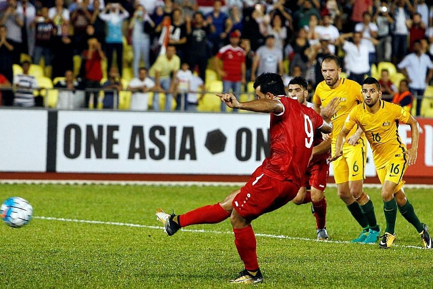 Syria's Omar al-Soma converts from the penalty spot on Thursday. The goal gave Syria a 1-1 draw and a lifeline ahead of Tuesday's second leg in Sydney.