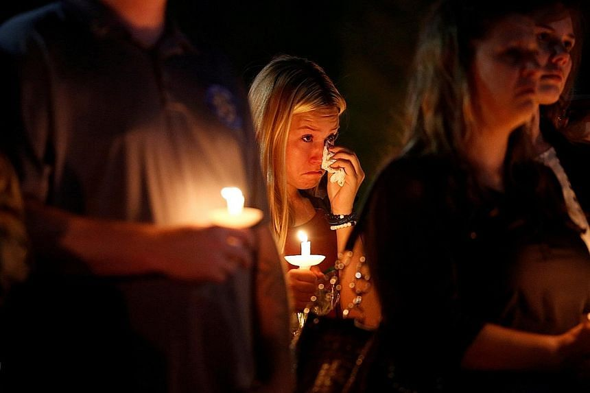 A candlelit vigil was held on Thursday for Mr Charleston Hartfield, an off-duty officer who was killed in the Las Vegas shooting on Sunday.