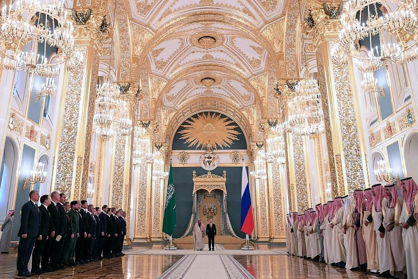 Saudi King Salman bin Abdulaziz and Russian President Vladimir Putin at a welcoming ceremony in the Kremlin, Moscow, on Thursday. During the first visit to Russia by a Saudi monarch, the two countries have already struck a deal on weapons sales and d