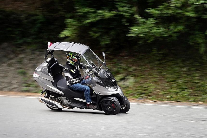The roof and wiper-equipped windscreen make the AD3 the right bike for wet weather.