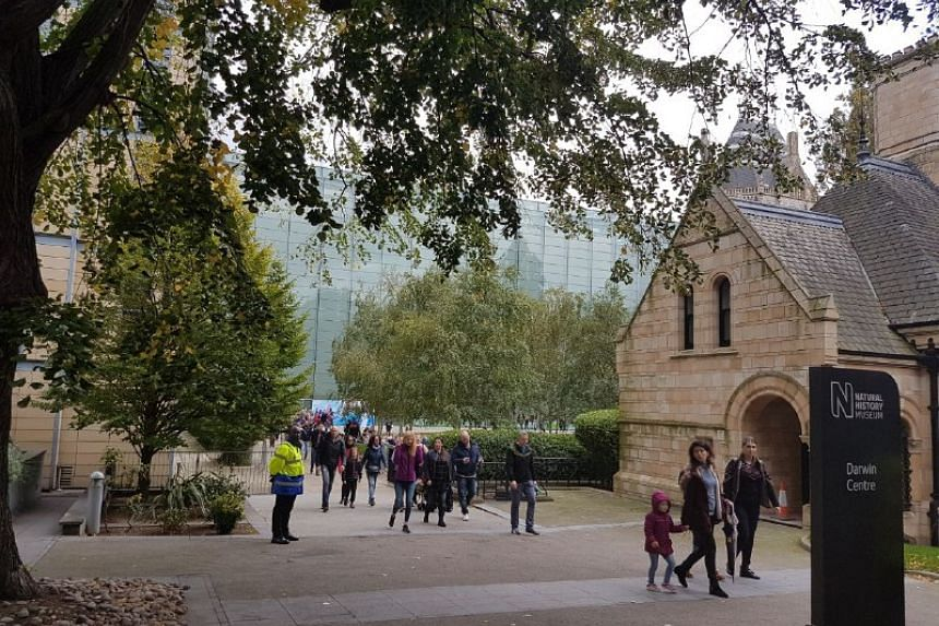 Visitors of the Natural History Museum make their way out through an alternative exit to avoid the closed area.