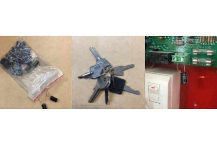 A bag of capacitors, universal keys to fire alarm panels and some tools were seized by the police on Oct 6, 2017.