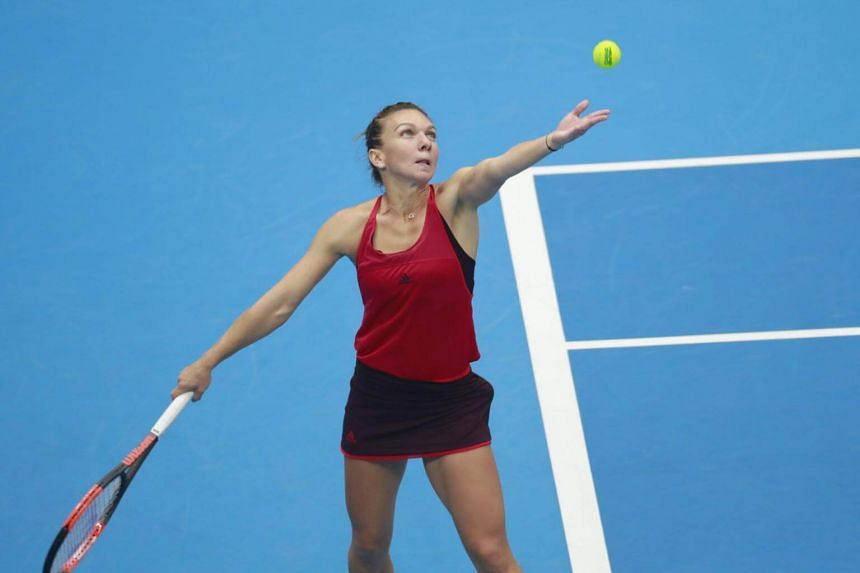 Simona Halep in action against Jelena Ostapenko during their women's singles semifinals match at the China Open tennis tournament at the National Tennis Center in Beijing, China on Oct 7, 2017.