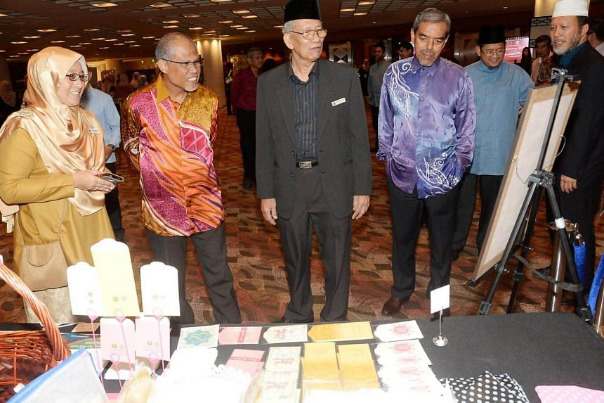Environment and Water Resources Minister Masagos Zulkifli (second from left) called on the community to develop and look to its own leaders.