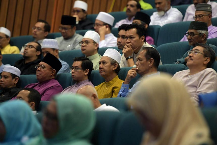 Attendees listen to Minister K Shanmugam's speech at a seminar for Islamic teachers held at the Muis auditorium on Oct 7, 2017.