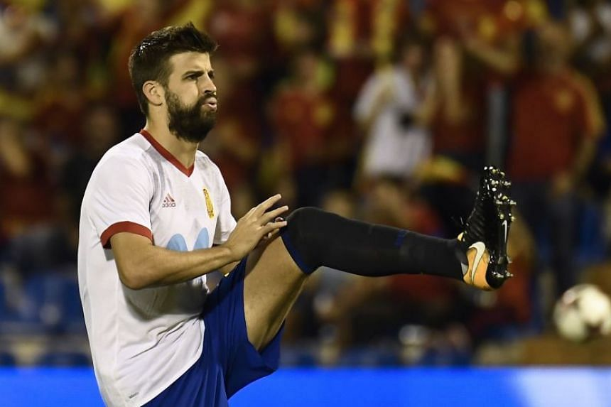 Pique warms up before the qualifier against Albania.