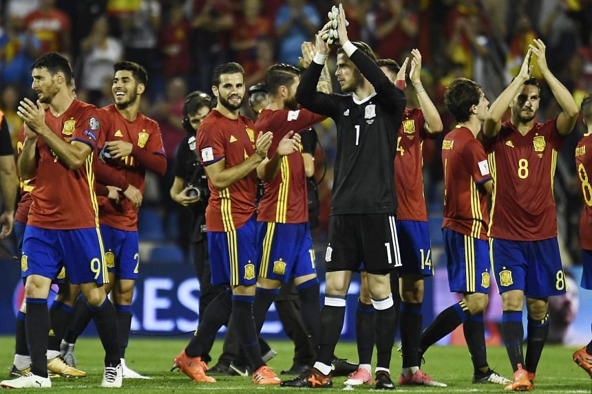 Spain team applaud at the end of the World Cup 2018 qualifier.