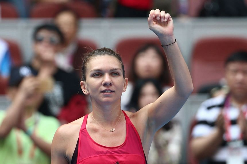 Simona Halep of Romania celebrates after defeating Daria Kasatkina of Russia during their women's singles quarterfinals match of the China Open tennis tournament at the National Tennis Center in Beijing, China, on Oct 6, 2017.