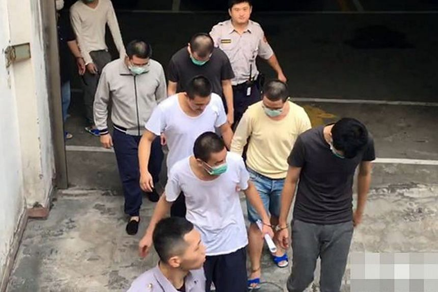 Four Singaporean men convicted of gang raping two drunken Taiwanese women in Taipei last December were sentenced by the Shilin District Court on Friday, Oct 6, 2017, but received only suspended sentences. Seen here are three of them: (front, right) B