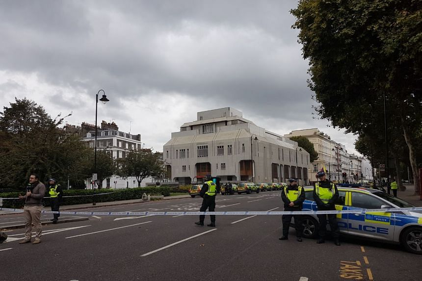 Police seal off Cromwell road outside the Victoria and Albert Museum.