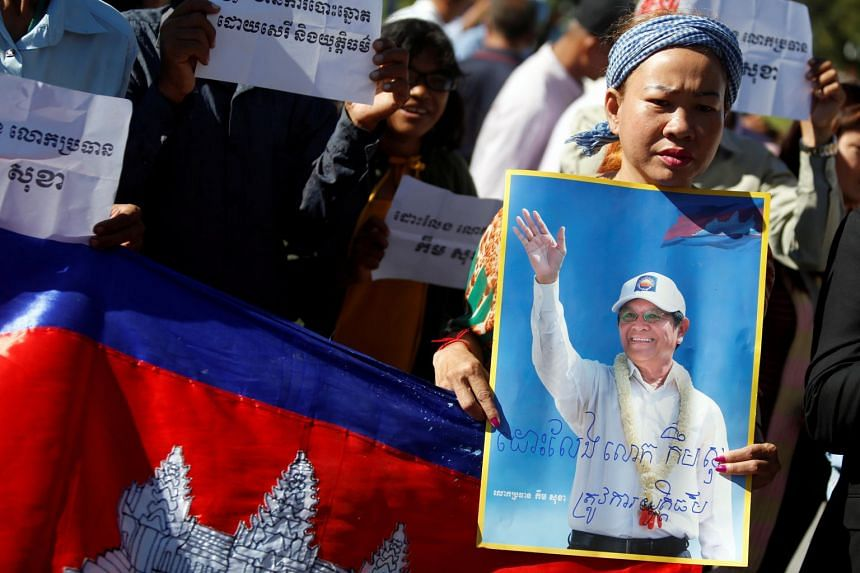 Supporters of leader of the Cambodia National Rescue Party Kem Sokha outside the Appeals Court in Phnom Penh last month. Kem Sokha was charged with treason following his arrest on Sept 3.