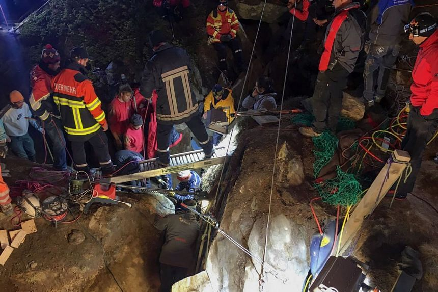 Rescuers work to pull the two-year-old girl out of the crevasse unharmed.